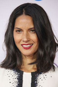 There's something really sexy about Olivia's super-dark locks framing her face. If you try the same look, we think your date will agree.   - Redbook.com