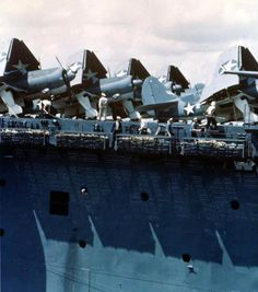 """USS Yorktown (CV 10), view showing Curtiss SB2C-1 """"Helldiver"""" aircraft on deck, probably taken during the carrier qualifications of SB2C, May 1943."""