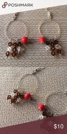 Silver colored hoops Silver colored wire hoops with Swarovski brown and clear beads and a dark orange bead on each. Handmade 😊 Jewelry Earrings