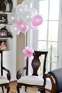 baby girl themed shower .... I love the idea of decorating the mommy to be's chair for opening gifts!