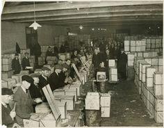 re-packing jaffa oranges in warehouse millwall dock London 1930