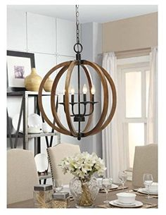Beautiful metal and wood frame orb chandelier. This farmhouse chandelier is the perfect farmhouse lighting accent - love it over a dining table or for an entryway. Farmhouse Light Fixtures, Farmhouse Chandelier, Kitchen Chandelier, Globe Chandelier, Rustic Chandelier, Farmhouse Lighting, Rustic Lighting, Chandelier Lighting, Kitchen Lighting