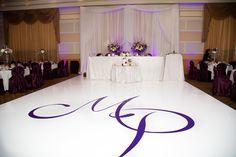 white backdrop with purple LED uplighting