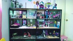 Monster High Dollhouse -  It was a shelving unit we had in the garage that we painted!  The wallpaper is simply scrapbook paper.  A lot of it is actual Monster High stuff that was mostly found online!