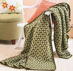 Interlocked Mosaic Afghan Crochet ePattern Afghan is a two-color design in which only one color is used per row (affiliate link)