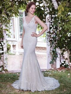 Rebecca Ingram - LAUREN, Romantic lace appliqués cascade over tulle and Inessa Jersey in this classic fit-and-flare wedding dress, with sheer illusion lace comprising the straps, V-neckline, and plunging V-back. Finished with zipper closure.  Available in plus size.