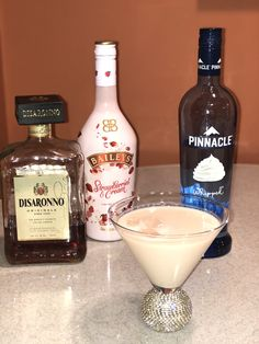 Strawberries and Cream Baileys  Nuts and Berries Martini  2 1/2oz Strawberries and Cream Baileys, 1oz Amaretto, 1/2 to 1oz whipped or vanilla vodka. Mix well with ice and Enjoy!