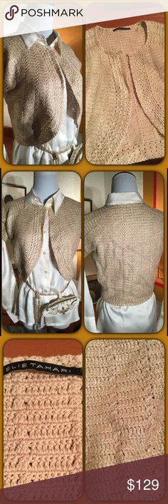 Elie Tahari Silk Cotton Bolero A total outfit completer! Looking for that something to top off your outfit that has some fab and class combo! This could be it! Beautiful woven gold metallic shrug/bolero. 70%cotton 30% silk top hook to close NWOT Elie Tahari Tops
