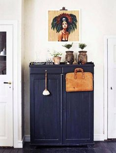 Utilize your storage units for way more than just their intended purpose. Deck the pieces with art, plants, and found objects to create an eye-catching accent within a room.