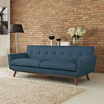Engage Upholstered Sofa in Azure. Available on LexMod.com.  Gently sloping curves and large dual cushions create a favorite lounging spot. Whether plopping down after a long day at work, settling in with coffee and brunch, or entering a spirited discussion with friends, the Engage sofa is a welcome presence in your home.