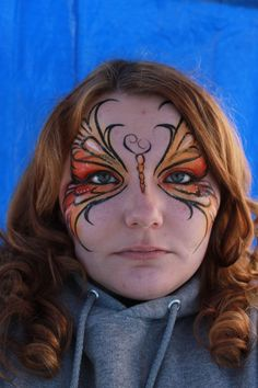 Butterfly face painting. Love the color choices here