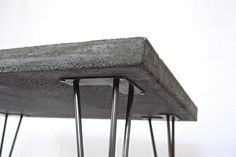 S O R T Contemporary practices in arts, design and subculture with design centred on severe aesthetics Handmade coffee table in solid grey concrete with raw steel hairpin legs. Each one is casted individually to order, in SORTs London based studio and custom designs are available upon request. All table tops are double sealed with protective concrete sealant and can be used for outdoor or indoor furniture. This listing is for one solid grey concrete coffee table with the following…