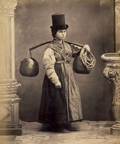 The water carrier. Did the cool hat come with the job?