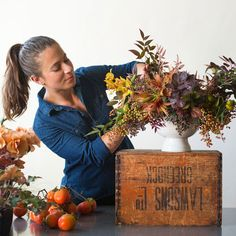 Once your foliage and texture elements are in place on your fall bouquet, look for natural dips and pockets among the sturdy branches of foliage where your flowers can rest.