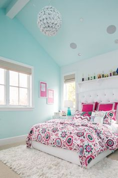 This bedroom is too darling, isn't it?! The upholstered bed is custom but we found a few similar. More Teenage Bedroom Ideas on Frugal Coupon Living. #TeenageBedrooms