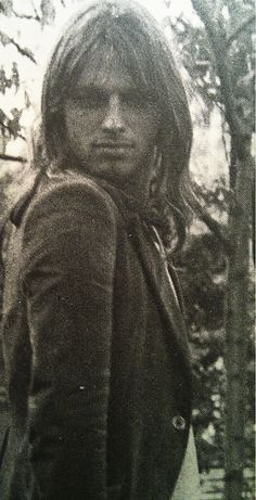A rare pose by David Gilmour in the early years.