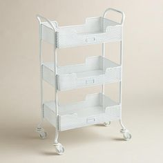 Featuring punched metal construction in fresh, bright white, it offers three trays to organize everything from mail and office supplies to toiletries and towels. >> #WorldMarket Storage and Organization