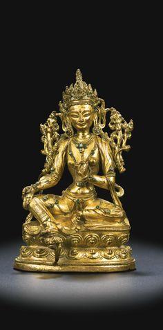 A gilt-bronze figure of Green Tara, Tibet, 15th century