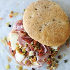 Panino Muffuletta         There are so many versions of the muffuletta sandwich around New Orleans, but it seems that Central Grocery in the French Quarter is the place to go. The store is charming enough, but at the back counter, seated on a stool with a muffuletta sandwich in front of you, is where you want to be. We sat down across from a man who told us he'd had his first muffuletta sandwich here fifty years ago and came back regularly for more. Next to him were a couple who have been…