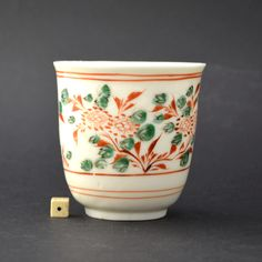 A rare 17th century Blanc de Chine porcelain beaker from a kiln in Dehua, Fujian province. Enamelled in Fujian province using typical so-called Swatow coloured enamels.