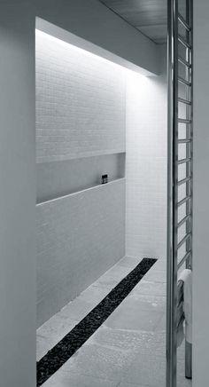 White brick, back light, white floor, black pebble strip