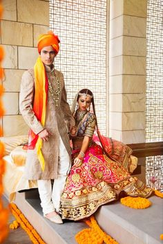 Indian wedding photography. Couple photo shoot ideas. Indian bride wearing bridal lehenga and jewelry. #IndianBridalHairstyle #IndianBridalMakeup Groom wearing sherwani and turban.