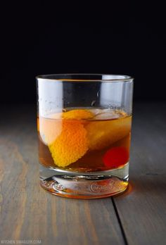 How to make an Old Fashioned drink. Orange peel, cherries, simple syrup, whiskey/bourbon, and bitters.