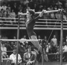 Gymnast Karin Janz performing on uneven bars (1968).