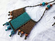 Eco friendly macrame necklace made with cotton cord, acai and wood beads.