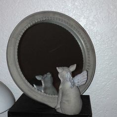 Saw this at Ross - absolutely gorgeous! Mirror with winged-pig. It's place is on the dresser.