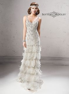 Gatsby inspired artistry makes a statement in this sheath wedding dress, Shauna by Sottero and Midgley. Complete with Swarovski crystal bodice and tiered feather skirt.
