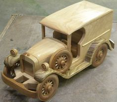 This replica is made from maple and hickory. It measures 13 inches long, 5 inches wide and 6 inches high. Details include steering wheel,
