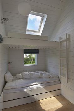 A setup that saves a lot of space and works well for visiting crowds, bunks (with under the bed storage) are another Nordic cottage staple: See 24 Built-In Bunks for Summer Sleepovers. This Danish summer house was designed by Norwegian JVA Architects via Bunk Rooms, Attic Rooms, Bedrooms, Attic Apartment, Attic Playroom, Attic Bathroom, Bunk Beds Built In, Little Houses, Small Houses