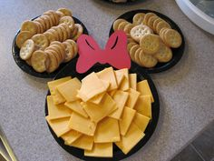 Mickey Mouse-shaped cheese (use cookie cutter) & Ritz crackers. cheese leftover from around the cut portion can be used on top of hamburgers