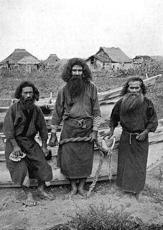 HAPPU KONNO, THE HUNTER (IN CENTRE), AND TWO AINU FISHERMEN.