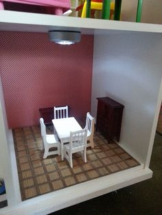 Our dollhouse from a Target Cubeical cube shelf organizer.  The dining room.