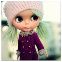 I think this style coat was on doll I had when I was little, and she had brown boots that went up to just below her knees.  (She had long brown hair too)