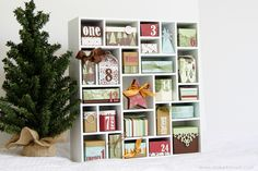 Christmas Advent Calendar Shadowbox idea: Using the Silhouette craft cutter to cut the boxes then assemble, can buy the paper in whatever patterns/colors. Include a bible verse and/or Christmas song along w/ a trinket/mini ornament in each box for T to hang on her tree