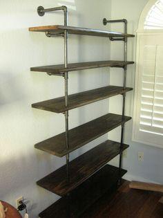 Gas-pipe bookshelf — click through for tutorial and photos.