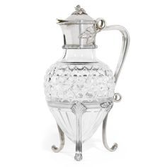A Fabergé silver-mounted cut glass decanter, Moscow, circa 1890, amphora form, the cylindrical collar within bound reeds, cast and chased foliate finial, leaf scroll handle, tripod stand, struck K.Fabergé in Cyrillic beneath the Imperial Warrant.