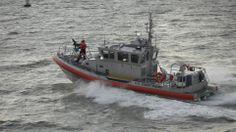 Coast Guard Cutter which escorts the Ferry
