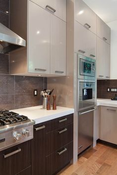 Kitchen Craft's high gloss 'Palermo' colour on the uppers and 'Chillagoe' on the lowers http://www.kitchencraftvancouver.com/