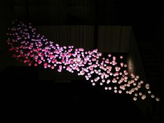 Swarm is one of eight interactive works selected for Re-ACT / Interactive Light Art – an exposition of art installations and objects, all with some form of built in interaction. It is a product of design collective called Blendid.