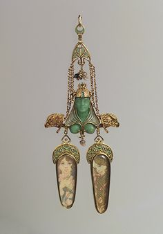 1900 brooch designed by Czech designer Alphonse Mucha,  made of gold, mother–of–pearl, opal, and emeralds.  #AntiqueJewelry #AntiqueBrooch