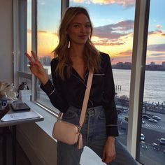 Martha Hunt wearing her CAMERA BAG with a WIDE STRAP and SHORT TASSEL