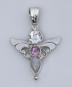 The 'Angel of Abundance' is handmade in Sterling Silver. This beautiful pendant designed by Shankari, is set with Pink Topaz, Rainbow Moonstone and White Topaz. This Shankari pendant will support your productivity, leading to new wealth and abundance in your life. http://store.shankari.com/jewelry/sterling-silver-pendants?product_id=2768