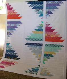 """I think this would be an easy/awesome block idea. I believe this likely uses 2.5"""" strips, so we could jelly-roll it with white or grey to create in a day."""