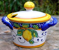 """This adorable little Italian ceramic sugar dish can be used for jam, jelly or honey. The lid is slotted to make room for a spoon. Hand painted by a family studio near Deruta, Italy--a village known for creating quality Italian Majolica pottery for hundreds of years.    Size: 5 1/2"""" diameter, 3 1/4"""" tall"""