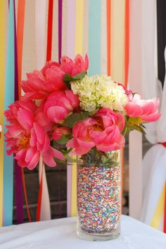 Sprinkle-Lined Vases for a Sprinkle Party.  @Tiffany Pope - see how they doubled up the vase inside to put water in for the flowers?  Good idea...