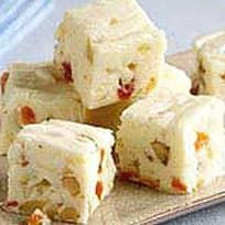 Ideal for gift-giving, this simple cooked fudge of white chocolate, sour cream and marshmallow creme is studded with walnuts and dried apricots. Fudge Recipes, Candy Recipes, Dessert Recipes, Desserts, Holiday Recipes, Fantasy Fudge, Dried Cherries, Dried Apricots, Dried Cranberries